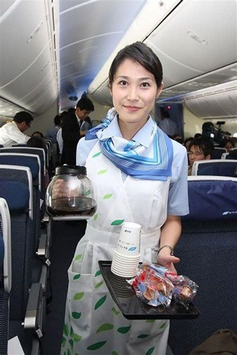 ANA cabin attendants in Boeing 787 are serving snack and