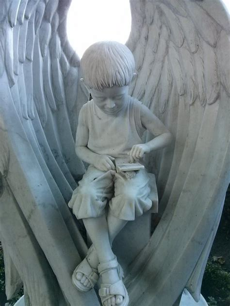 RIP: Tombstone Statue Of Young Boy Playing Pokemon