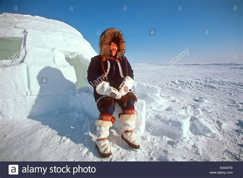 Alaskan Eskimo Woman sitting outside igloo Nome AK Western